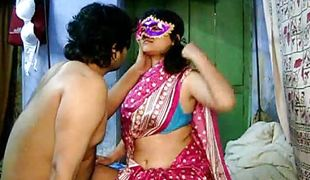 Indian Fellow plays with Savita`s belly