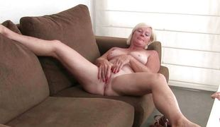 Attractive grandmoms enjoys masturbating in solo.