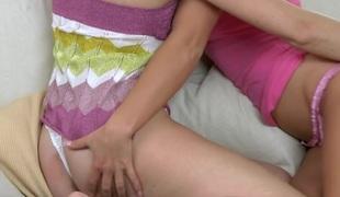 Ravishing dyke is having a vehement lesbo sex on touching girlfriend