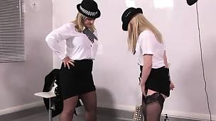Uniform mistresses pissing on sissy thrall