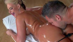 Curvy milf blond Phoenix Marie is with her face with respect to on rub down table and finds her thong pants removed by dirty masseur. He gives her rectal hole a lick and then fucks her covered in oil up pussy doggy style!